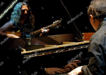 Spanish Flamenco Guitarist Jose Fernandez Torres (l) Known As 'Tomatito' Performs on Stage Late Wednesday 12 July 2006 at the Guitar Festival of Cordoba Tomatito Presented 'Spain Again' with Pianist Michel Camilo (r) Spain Cordoba