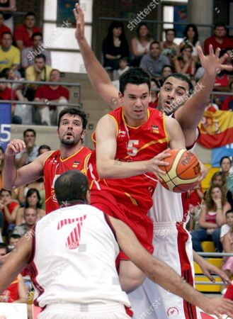Spain's Player Rafa Martinez (c) Tries to Score Before Egyptian Taerk El Ghannam (r) and Wael Bader (front) During Their Basketball Match at Almeria Mediterranean Games in El Ejido Town Almeria Province Andalucia Region Saturday 25 June 2005 Spain El Ejido