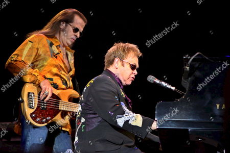 Stock Image of British Singer and Composer Elton John (r) Plays the Piano Beside His Bass Player Bob Birch During His Only Concert in Spain at Adeje's Golf Club in Tenerife Canary Islands 24 January 2008 Spain Tenerife