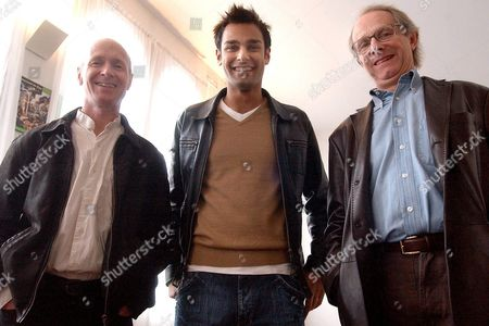 British Film Director Ken Loach (r) Poses with Atta Yaqub (c) and Paul Laverty (l) the Male Lead and Scriptwriter Respectively of His Latest Film 'Ae Fond Kiss' That Will Be Shown on Thursday 28 October 2004 at the Seminci Film Festival at Valladolid in Northwestern Spain Spain Valladolid