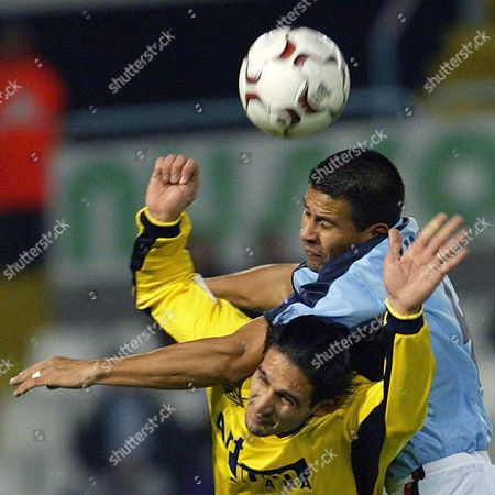 Alaves' Martin Estudillo (foreground) and Celta's Francisco Caceres (rear) Head the Ball During Their Spanish King Cup Soccer Match Played at the Balaidos Stadium in Vigo on Wednesday 28 January 2004 Spain Vigo