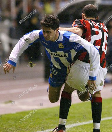 Deportivo De La Coru±a's Victor Sanchez (l) Collides with Ac Milan's Giuseppe Pancaro (r) During Their Uefa Champions League Quarter Final Second Leg Soccer Match at the Riazor Stadium in La Coru±a Wednesday 07 April 2004 Spain La Coru?a