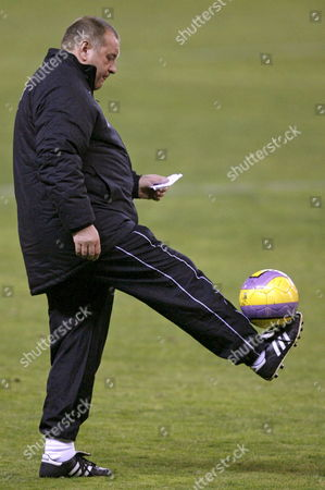 Aberdeen's Coach Jimmy Calderwood Plays with the Ball During a Training Session at Vicente Calderon Stadium in Madrid Spain 28 November 2007 Ahead Their Uefa Cup Soccer Match Against Atletico Madrid on 29 November 2007 Spain Madrid