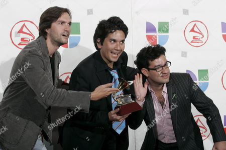 Members of the Group Bacilos (l-r) Andre Lopes of Brazil Jorge Villamizar of Colombia and Jj Freire of Puerto Rico Pose For a Picture with Their Latin Grammy They Won For Best Pop Album by a Duo Or a Group with Vocal 'Sinverguenza' at the 6th Annual Latin Grammy Awards at the Shrine Auditorium in Los Angeles Thursday 03 November 2005 United States Los Angeles