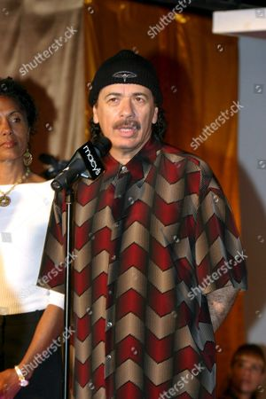 Carlos (r) and Deborah Santana (l) Present the New Carlos Shoe Collection at Macy's Department Store in New York City Wednesday 15 June 2005 a Portion of the Proceeds From the Sales Benefit the Deborah and Carlos Santana Milagro Foundation For Children United States New York