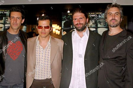 From L to R Mexican Actor Jose Maria Yazpik Colombian-born Actor John Leguizamo Ecuadoran Director Sebastian Cordero and Mexican Producer Alfonso Cuaron Pose on the Red Carpet During the Premiere of Their Movie 'Cronicas' (chronicles) at the Angelika Theather in New York Ny Usa Tuesday 28 of June 2005 United States New York
