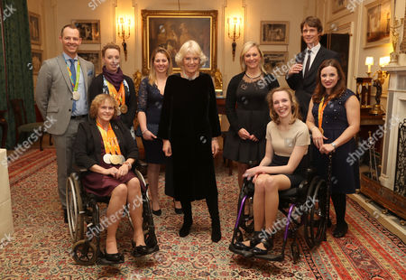 Camilla Duchess of Cornwall (C) with (L-R) Equestrians Spencer Wilton, Anne Dunham, Sophie Wells, Kitty King, Gemma Tattersall, Sophie Christensen, William Fox-Pitt and Natasha Baker during a reception for the British Equestrian teams who took part in the 2016 Olympic and Paralympic games at Clarence House