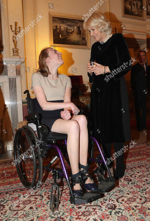 Stock Photo of Camilla Duchess of Cornwall (R) with para-equestrian Sophie Christiansen as she hosts a reception for the British Equestrian teams who took part in the 2016 Olympic and Paralympic games at Clarence House
