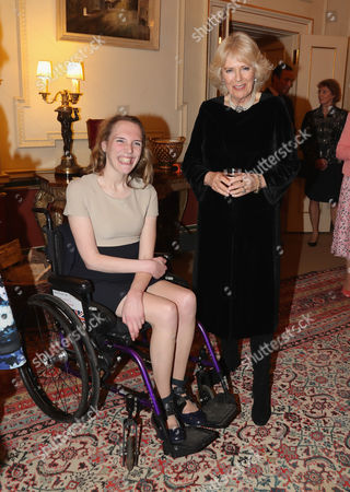 Camilla Duchess of Cornwall (R) with para-equestrian Sophie Christiansen as she hosts a reception for the British Equestrian teams who took part in the 2016 Olympic and Paralympic games at Clarence House