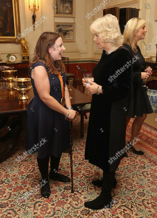 Camilla Duchess of Cornwall (R) with para-equestrian Natasha Baker during a reception for the British Equestrian teams who took part in the 2016 Olympic and Paralympic games at Clarence House