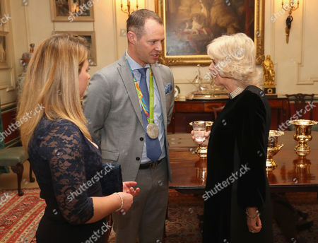 Camilla Duchess of Cornwall (R) with equestrians Kitty King (L) and Spencer Wilton during a reception for the British Equestrian teams who took part in the 2016 Olympic and Paralympic games at Clarence House