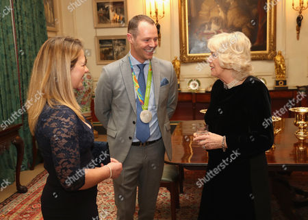 Stock Image of Camilla Duchess of Cornwall (R) with equestrians Kitty King (L) and Spencer Wilton during a reception for the British Equestrian teams who took part in the 2016 Olympic and Paralympic games at Clarence House