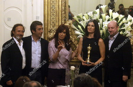 Argentinean President Cristina Fernandez De Kirchner (c) Receives Juan Jose Campanella (r) Director of the Argentinean Winner of the Oscar For 'Best Foreign Language Film' Called 'The Secret in Their Eyes' (el Secreto De Sus Ojos) and Actors Soledad Villamil (2-r) Ricardo Darin (2-l) and Guillermo Francella (l) at the Presidential Residence Casa Rosada in Buenos Aires Argentina 18 March 2010 Argentina Buenos Aires