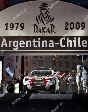 French Luc Alphand (l) and Gilles Picard (r) of the Repsol Mitsubishi Ralliar Team at the Symbolic Start of the Argentina-chile 2009 Rally Dakar Buenos Aires Argentina on 2 January 2009 the Rally Which Includes a Journey of 9 574 Km Runs From 03 Through 18 January Argentina Buenos Aires