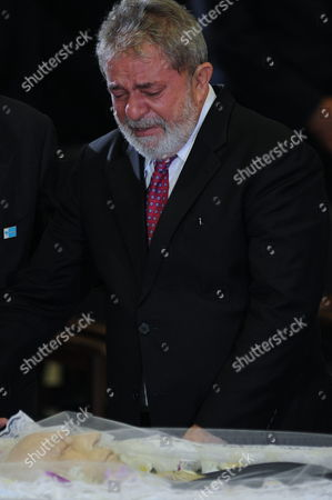 Former Brazilian President Luiz Inacio Lula Da Silva Cries Over the Body of Former Brazil Vice President Jose Alencar in the Planalto Palace of Brasilia Brazil on 30 March 2011 During the Funeral of Alencar who Died on Tuesday Victim of an Aggressive Cancer Brazil Brasilia