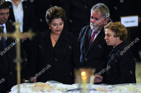 Stock Photo of Former Brazilian President Luiz Inacio Lula Da Silva (c) His Wife Marisa Leticia (r) and Brazilian Head of State Dilma Rousseff (l) Watch the Body of Former Brazil Vice President Jose Alencar in the Planalto Palace of Brasilia Brazil on 30 March 2011 During the Funeral of Alencar who Died on Tuesday Victim of an Aggressive Cancer Brazil Brasilia