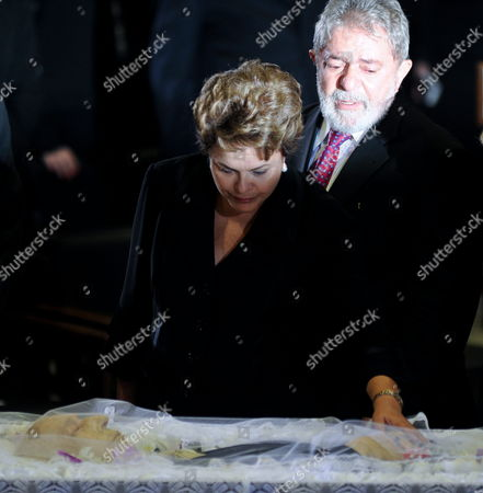 Former Brazilian President Luiz Inacio Lula Da Silva (r) and Brazilian Head of State Dilma Rousseff (l) Watch the Body of Former Brazil's Vice President Jose Alencar in the Planalto Palace of Brasilia Brazil on 30 March 2011 During the Funeral of Alencar who Died on Tuesday Victim of an Aggressive Cancer Brazil Brasilia