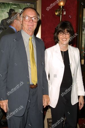 """Nick Pileggi (left) and Nora Ephron arriving to the premiere of Dreamworks' """"The Road to Perdition"""" at the Ziegfeld Theatre in New York City on July 9, 2002.  Manhattan, New York  Photo® Matt Baron/BEImages.net"""