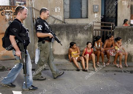 Brazilian Policemen During an Operation to Search For the Kidnappers of the Vietnamese Diplomat Vu Thanh Nam and Three Chinese Citizens who Escaped From Their Captors at the Vila Cruzeiro Shanty Town in Rio De Janeiro Brazil 19 August 2008 Close to 250 Policemen Took Part in the Operation Assisted by One of the Hostages Chinese Liu Chang Hong Brazil Rio De Janeiro