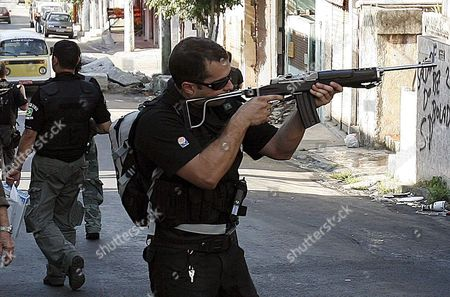 A Brazilian Policeman Takes Aim During an Operation to Search For the Kidnappers of the Vietnamese Diplomat Vu Thanh Nam and Three Chinese Citizens who Escaped From Their Captors at the Vila Cruzeiro Shanty Town in Rio De Janeiro Brazil 19 August 2008 Close to 250 Policemen Took Part in the Operation Assisted by One of the Hostages Chinese Liu Chang Hong Brazil Rio De Janeiro