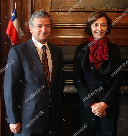 Chilean Treasury Minister Felipe Larrain (l) Poses Next to the French Secretary of State Anne Marie Idrac (r) As They Met at the Audience Room of the Chilean Ministry in Santiago Chile on 20 July 2010 Chile Santiago