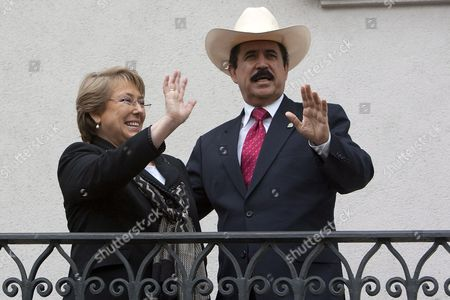 Stock Picture of Chilean President Michelle Bachelet (l) and Her Ousted Honduran Counterpart Manuel Zelaya (r) Wave at La Moneda Palace in Santiago Chile 13 August 2009 After His Arrival to the South American Country Zelaya Urged the Usa to Fight Against the De Facto Government of Roberto Micheletti Chile Santiago