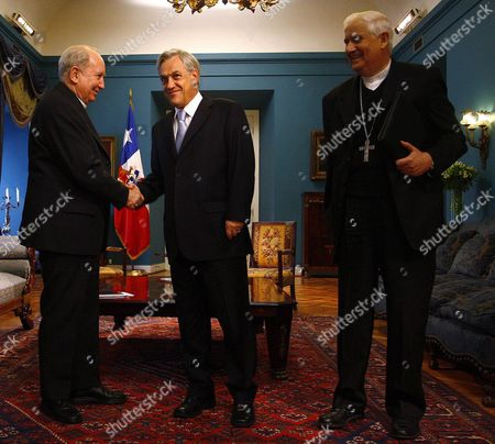 Chilean President Sebastian Pinera (c) Receives Archbishop of Santiago Cardenal Francisco Javier Errazuriz (l) and President of Episcopal Conference Monsignor Alejandro Goic (r) at Palacio La Moneda in Santiago Chile 21 July 2010 Chilean Catholic Church Presented the Government a Proposal of Amnesty That Includes Human Rights Violators Chile Santiago
