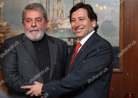 Chilean Energy and Mining Minister Laurence Golborne (r) Shakes Hands with Former Brazilian President Inacio Lula Da Silva (l) During a Meeting in Santiago De Chile Chile 05 July 2011 Lula Met Some of the Chilean Miners Rescued From the San Jose Mine Chile Santiago De Chile