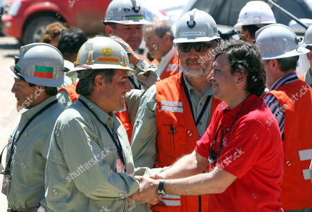 Chilean Rescuer Manuel Gonzalez (l) the First and the Last One on the 'Fenix 2' Capsule is Greeted by Chilean Minery Minister Laurence Golborne (r) at the San Jose Mine Near Copiapo Chile on 14 October 2010 After the Rescue Operation of the 33 Trapped Miners Chile Copiapo
