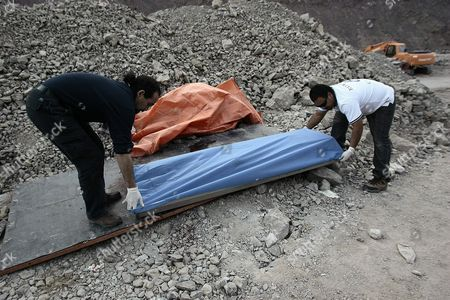 Legal Medical Service Officials Carry the Body of 40 Year Old Homero Aguirre who Died Along with 24 Year Old Miner Daniel Lazcano After an Accident at the Deposit Los Reyes Chile on 08 November 2010 Near San Jose where 33 Miners Had Been Buried Underground For 70 Days Until They Were Rescued on 13 October Chilean Mining Minister Laurence Golborne Confirmed the Death of Both Miners and Stated That the Mine Had Been Operating Illegally Chile Copiapo