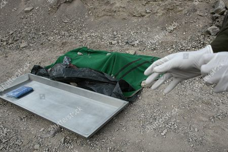 View of the Body of 40 Year Old Homero Aguirre who Died Along with 24 Year Old Miner Daniel Lazcano After an Accident at the Deposit Los Reyes Chile on 08 November 2010 Near San Jose where 33 Miners Had Been Buried Underground For 70 Days Until They Were Rescued on 13 October Chilean Mining Minister Laurence Golborne Confirmed the Death of Both Miners and Stated That the Mine Had Been Operating Illegally Chile Copiapo