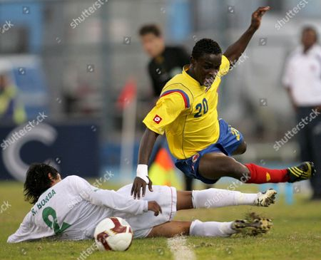 Stock Image of Bolivia's Soccer National Team Player Rodrigo Borda (l) Fights For the Ball with Colombia's John Steven Mendoza (r) During Their South American Under 17 Soccer Match to the World Cup Nigeria 2009 at the Tierra De Campeones De Iquique Stadium in Iquique Chile 09 May 2009 Colombia Won 2-1 Chile Santiago