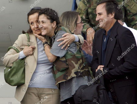 Colombian-french Former Presidencial Candidate Ingrid Betancourt (c) Hugs Her Mother Yolanda Pulecio (l) Along with Her Husband Juan Carlos Lecompte (r) at Her Arrival to the Militar Airport of Catam in Bogota Colombia on 02 July 2008 After Being Rescued by the Colombian Army in the Jungle of the Eastern Department of Guaviare After a Long Hostage by the Farc Guerrilla with Betancourt Also was Rescued the Three Us Citizens and Other 11 Colombian Military Troops Colombia Tolemaida