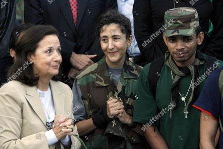 Colombian-french Former Presidencial Candidate Ingrid Betancourt (c) Her Mother Yolanda Pulecio (l) and First Corporate Wiliam Perez Betancourt's Nurse During Kidnapping Pray at Her Arrival to the Military Airport of Catam in Bogota Colombia on 02 July 2008 After Being Rescued by the Colombian Army in the Jungle of the Eastern Department of Guaviare After a Long Hostage by the Farc Guerrilla with Betancourt Together Three Us Citizens and Other 11 Colombian Military Troops Were Rescued Colombia Tolemaida