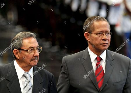 Stock Photo of Cuban President Raul Castro (l) and Jamaican Prime Minister Orette Bruce Golding (r) Review the Honor Guard During the Welcome Ceremony at the Revolution Palace in Havana Cuba 05 May 2008 Golding is on an Official Visit to Cuba and is the First Head of Government That Have an Official Meeting with Raul Castro After He Replace His Brother Fidel Cuba Havana
