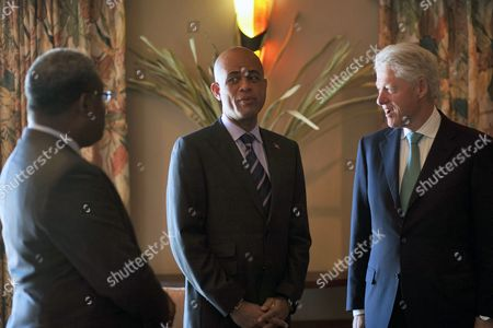 Haitian President-elected According to Preliminary Results by Electoral Authorities Michel Martelly (c) Talks to Co Presidents of Interin Commission For Rebuilding of Haiti (cirh) Haitian Primer Minister Jean Max Bellerive (l) and U S Former President Bill Clinton (r) at a Hotel of Port-au-prince Haiti 08 April 2011 Haiti Port-au-prince