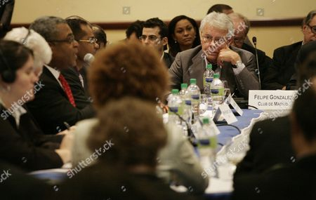 Former Spanish Prime Minister Felipe Gonzalez (r) Listens to Haitian Prime Minister Jean Max Bellerive (3l) During a Meeting of the Interim Commission For the Reconstruction of Haiti at the Karibe Hotel in Port-au-prince Haiti on 15 February 2011 a Club of Madrid Mission is Visiting the Caribbean Nation to Examine the Political and Social Situation of the Country Haiti Port-au-prince