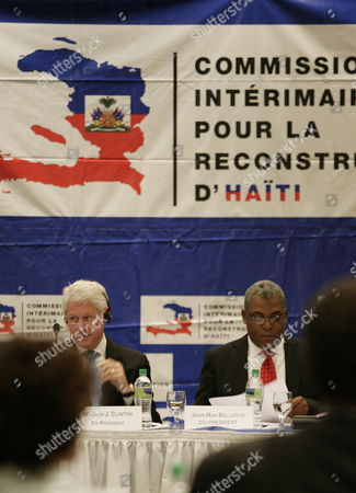 Former Us President Biil Clinton (l) and Haitian Prime Minister Jean Max Bellerive (r) Attend a Meeting of the Interim Commission For the Reconstruction of Haiti at the Karibe Hotel in Port-au-prince Haiti on 15 February 2011 a Club of Madrid Mission is Visiting the Caribbean Nation to Examine the Political and Social Situation of the Country Haiti Port-au-prince