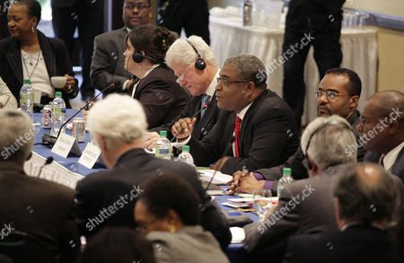 Former Us President Biil Clinton (cl White Hair) and Haitian Prime Minister Jean Max Bellerive (cr) Along with Other Participants Attend a Meeting of the Interim Commission For the Reconstruction of Haiti at the Karibe Hotel in Port-au-prince Haiti on 15 February 2011 a Club of Madrid Mission is Visiting the Caribbean Nation to Examine the Political and Social Situation of the Country Haiti Port-au-prince
