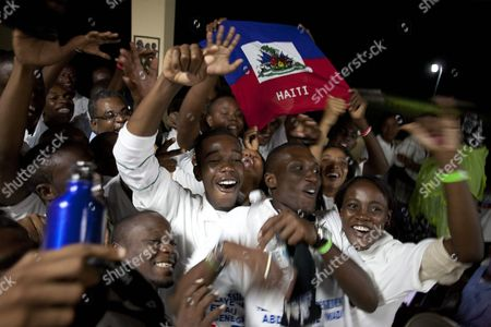 Haitian Prime Minister Jean Max Bellerive (3l-up) Celebrates Accompanied by Some of the 160 Haitian Students who Received a Scholarship by the Government of Dakar and Will Travel to Senegal in the Next Hours From Port-au-prince Haiti 12 October 2010 Senegal is Allowing 160 Haitian Students Victims of the January 12 Deadly Earthquake to Continue Their Studies in Senegal's Universities Haiti Port-au-prince