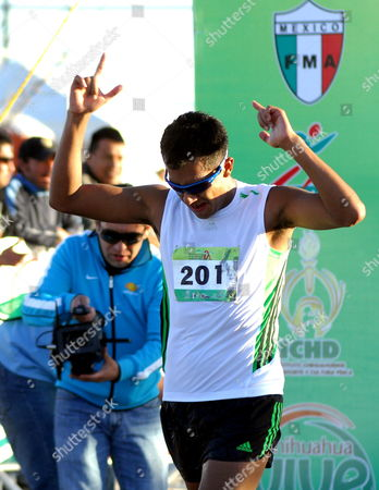 Stock Photo of Mexican Athlete Eder Sanchez Crossed the Finish Line and Won the Gold Medal After the 20 Kilometers Men Test at the World Cup of Chihuahua in the City of Chihuahua Mexico 05 March 2011 Mexican Jose Leyver Won the Gold Medal Mexico Chihuahua