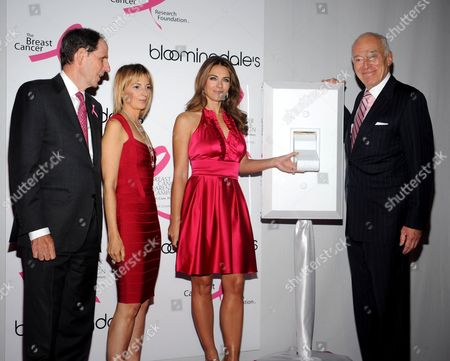 Stock Picture of CEO of Bloomingdale's Michael Gould, Marisa Acocella Marchetto, actress Elizabeth Hurley, and Chairman of the board at Estee Lauder Leonard Lauder