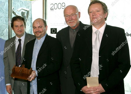 Stock Picture of Barcelona Mayor Jordi Hereu (l) Poses with Architects Craig Edward Dykers (2l) Kjetil Trµdal Thorsen (r) and Tarald Lundevall (r) of the Norwegian Architecture Studio Snohetta After They Received the European Union Prize For Contemporary Architecture-mies Van Der Rohe Award 2009 For Their Work on the Norwegian National Opera and Ballet in Oslo 28 May 2009 in Barcelona Spain Epa/andreu Dalmau Spain Barcelona