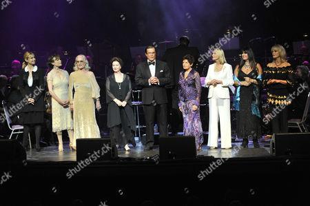 Roger Moore and Bond Girls - Maryam D'Abo, Madeleine Smith, Shirley Eaton, Zena Marshall, Eunice Gayson, Tania Mallett, Caroline Munro and Joanna Lumley