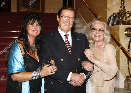 Caroline Munro, Roger Moore and Shirley Eaton