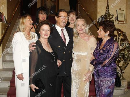 Stock Image of Roger Moore and Bond Girls (Tania Mallett, Caroline Munro, Zena Marshall, Madeleine Smith, Shirley Eaton and Eunice Gayson)