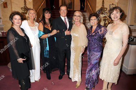 Stock Picture of Roger Moore and Bond Girls - Zena Marshall, Tania Mallett, Caroline Munro, Shirley Eaton, Eunice Gayson and Madeleine Smith