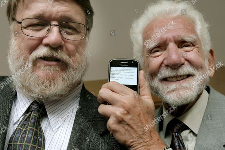 Us Engineers Martin Cooper (r) and Raymond Samuel Tomlinson (l) Pose For Photographers Next to a Gallery with Cellphones During an Event at Oviedo's University in Oviedo Northern Spain 22 October 2009 Cooper and Tomlinson Will Be Awarded with the 2009 Prince of Asturias Technical and Scientific Research Award at a Traditional Ceremony Tomorrow in the Asturian Capital the Prince of Asturias Awards Are Held Annually Since 1981 to Reward Scientific Technical Cultural Social and Humanitarian Work Done by Individuals Work Teams and Institutions Spain Oviedo