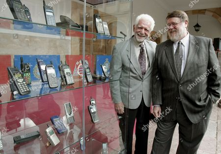 Us Engineers Martin Cooper (l) and Raymond Samuel Tomlinson (r) Pose For Photographers Next to a Gallery with Cellphones During an Event at Oviedo's University in Oviedo Northern Spain 22 October 2009 Cooper and Tomlinson Will Be Awarded with the 2009 Prince of Asturias Technical and Scientific Research Award at a Traditional Ceremony Tomorrow in the Asturian Capital the Prince of Asturias Awards Are Held Annually Since 1981 to Reward Scientific Technical Cultural Social and Humanitarian Work Done by Individuals Work Teams and Institutions Spain Oviedo