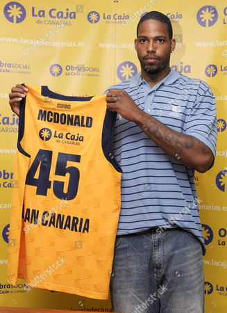 Us Pivot Will Mcdonald Poses with the T-shirt of Gran Canaria 2014 Team During His Presentation As New Player of the Club in Las Palmas De Gran Canaria Canary Island Spain 28 August 2009 Spain Las Palmas De Gran Canaria